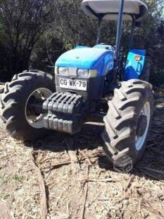 Tractor New Holland con Grape forestal